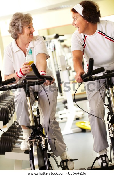 Two retired women spending time in gym