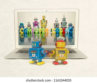 two retro bobots learn about codeing on a laptop computer isolated
