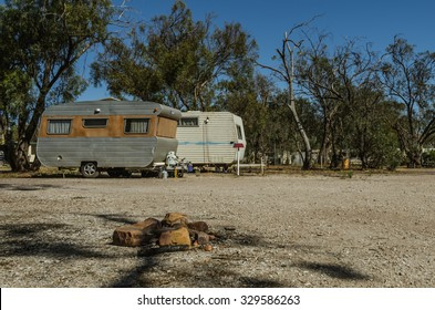 Two retro caravan trailers at camping ground in the bush