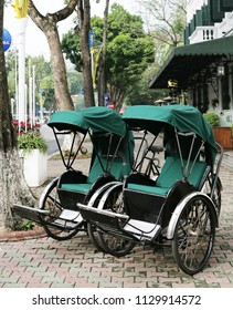 Two retro green cyclo in Hanoi (cyclo is traditional hiring vehicle for passenger in Vietnam)