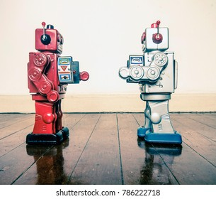 two retro robots face off with ray guns on a wooden floor with reflection