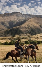 Two riders fighting for possession of goat carcass in game of Kokpar in Aksu-Zhabagly Nature Reserve, Kazakhstan - September 9, 2016