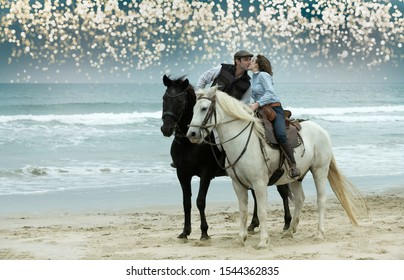two riders are training their horses on the beach