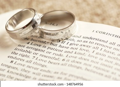 Two rings on open Bible - 1. Corinthians chapter 13.