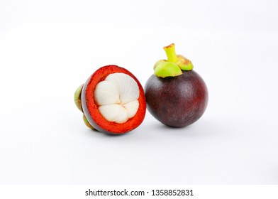 two ripe mangosteen isolated on white background closeup