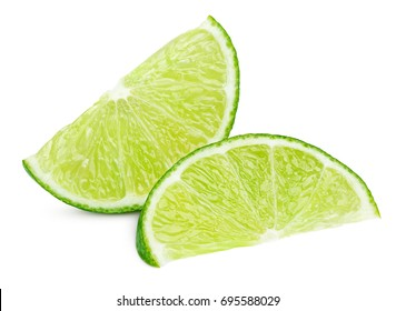 Two ripe slices of green lime citrus fruit isolated on white background with clipping path