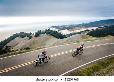 Two road bikers on Ridgecrest Blvd. above Stinson Beach, CA.