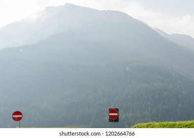 Two road signs no enter in misty mountains