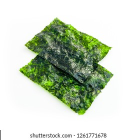 Two roasted sheets of seaweed, isolated on white background. Asian healthy dry nori snack food.