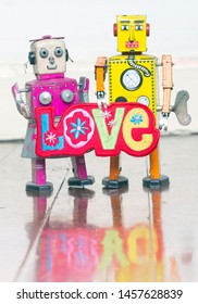 two robots in love on a old wooden flor