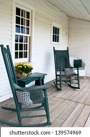Two rocking chairs create a peaceful scene on this old porch.