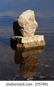 two rocks balancing in the water