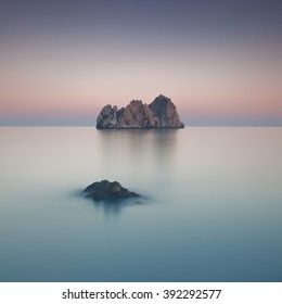 Two rocks in the calm and stunning sea