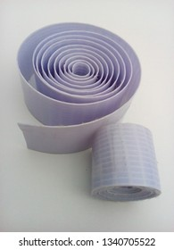 two rolls of plain vinyl flexion material insulated white background