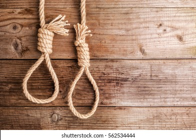 two ropes knotted in noose on wooden background