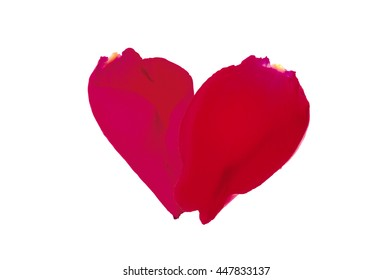 Two rose petals in a heart shape on white background. Flat lay