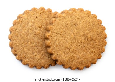 Two round gingerbread biscuits isolated on white from above. Serrated edge.