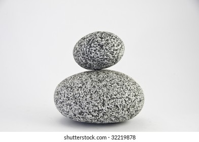 Two round granite rocks of different size. They are on a white background.