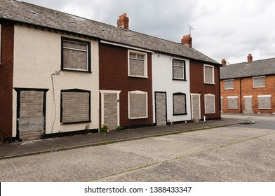 Two rows of derelict houses