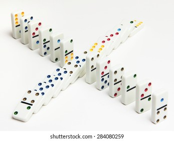 Two rows of dominoes - standing and fallen