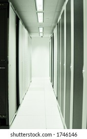 Two rows of server racks in a modern datacenter.