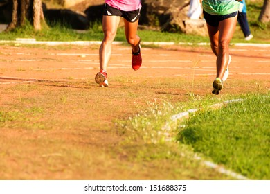 Two runners running in the urban field