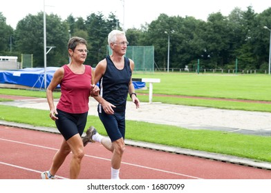 Two running pensioners having a healthy lifestyle.