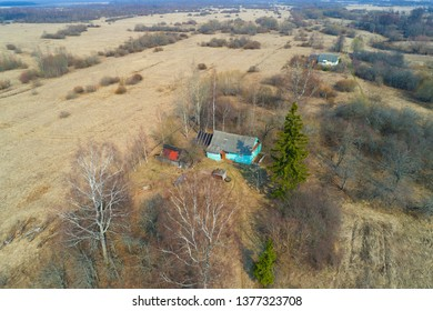 Two rural houses in the April landscape (aerial survey). Novgorod region, Russia