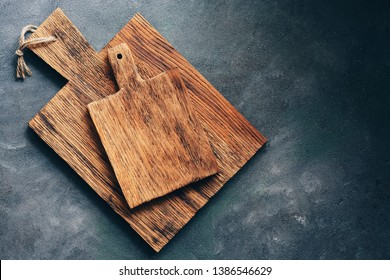 Two rustic wooden cutting board on a gray background. Top view, flat lay, copy space
