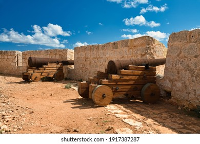 Two rusty cannons at Saint Mary's Battery. Old artillery battery from the 18th century on the island of Comino in Malta. It is a popular tourist destination on the coastline of the island. Europe.