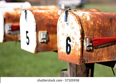 Two rusty mailboxes