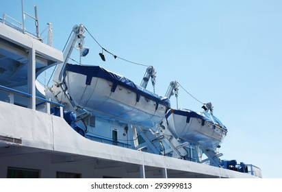 Two safety lifeboat, small boat hanging on the deck of the cruise ship
