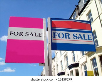 Two for sale sign in English street, with space for company names.