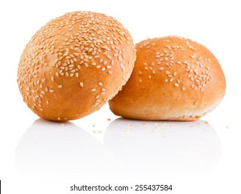 Two sandwich bun with sesame seeds isolated on white background