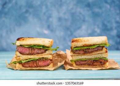 two sandwich katsu sando with beef steak. wagyu katsu. japanese cuisine traditional food. Trendy healthy fast food snack