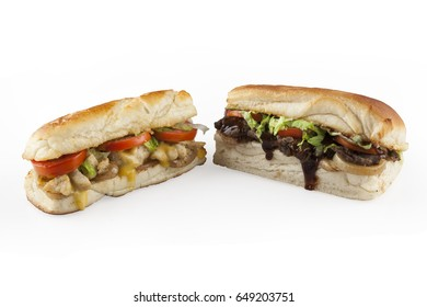 Two sandwiches, chicken and beef