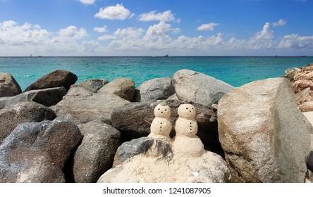 two sandy snowman in Caribbean