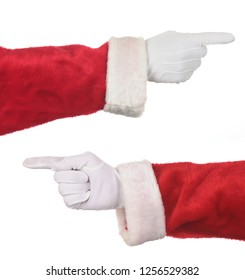 Two Santa Claus hands pointing. Hands and arms only in horizontal format isolated on white.