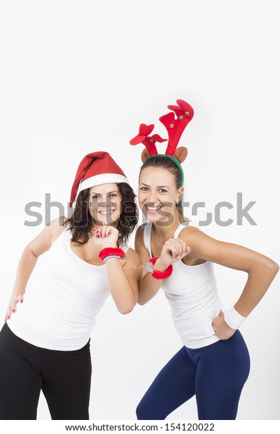 Two Santa Girls making gifts for Christmas holiday
