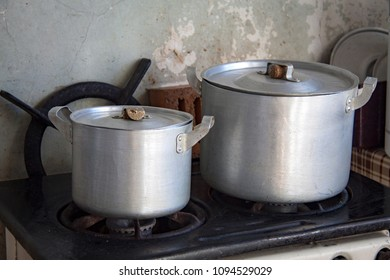 Two saucepans on a gas stove