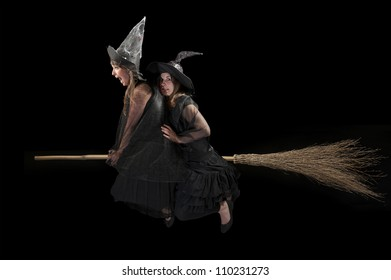 two scared witches flying on a broom