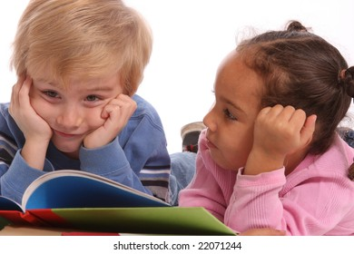 two school aged kids looking at books