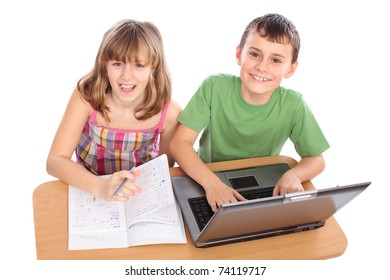 Two school children doing homework together with computer, isolated on white background