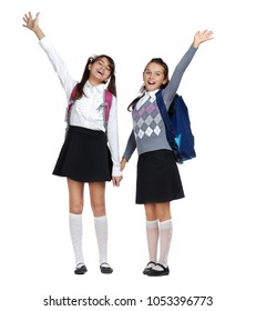 Two schoolgirls friends expressing joy and happiness