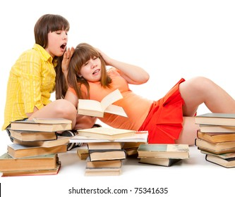 Two schoolgirls were tired of reading books and want to sleep