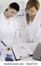 Two scientists conducting an experiment in a lab