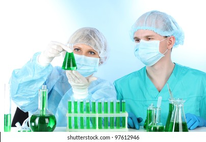 two scientists working in chemistry laboratory