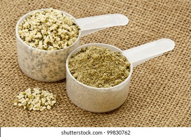 two scoops of raw organic hemp protein powder and shelled hemp seeds - super food rich in nutrients (proteins, antioxidants, amino and fatty acids)