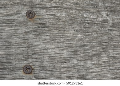 two screws on wood background
