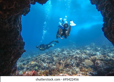 Two scuba divers in a cave in Puerto Rico